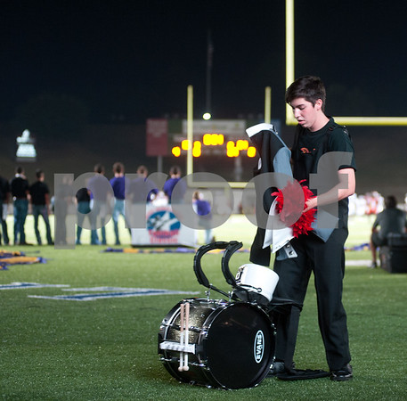 photo by Sarah A. Miller/Tyler Morning Telegraph   Robert E. Lee marching band player bass drum player junior Ethan Elkins puts on his uniform before the start of their halftime show at the football game between Robert E. Lee High School and Lufkin Friday night at Trinity Mother Frances Rose Stadium in Tyler.