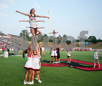 photo by Sarah A. Miller/Tyler Morning Telegraph  Robert E. Lee cheerleaders hold up sophomore Nayelie Molina in an arabesque stunt before the football game between Robert E. Lee High School and Lufkin Friday night at Trinity Mother Frances Rose Stadium in Tyler.