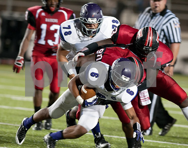 photo by Sarah A. Miller/Tyler Morning Telegraph  Lukin's (6) junior running back Steven Sowell is tackled by  Robert E. Lee's linemen (90) senior Triston Taylor and (53) senior Amier Wilson players at the football game between Robert E. Lee High School and Lufkin Friday night at Trinity Mother Frances Rose Stadium in Tyler.
