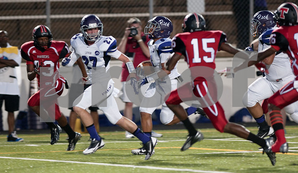 photo by Sarah A. Miller/Tyler Morning Telegraph  Lukin's (6) junior Steven Sowell makes a touchdown run at the football game between Robert E. Lee High School and Lufkin Friday night at Trinity Mother Frances Rose Stadium in Tyler.