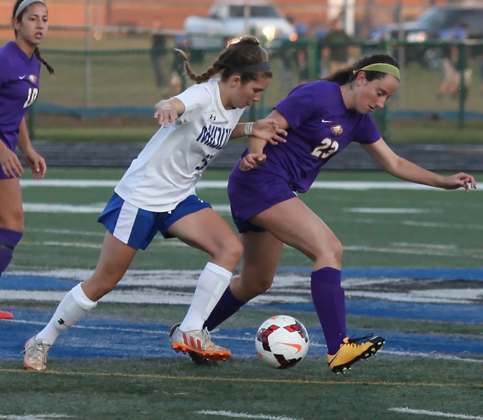 Midview's Izzy Mraz battles Kelsely Gannon of Avon for the ball near midfield during the first half. Randy Meyers -- The Morning Journal