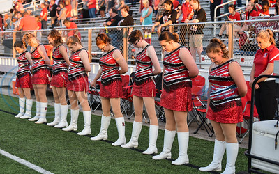 The Rusk twirlers bow their head in a moment of silence before their game against Athens on Friday, September 6. The Eagles traveled to Athens for the game and will play Palestine at home next on Friday, September 13. (Jessica T. Payne/Tyler Morning Telegraph)