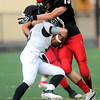 Fairview's Andrew Cobb (right) tackles Rangeview's Zach Zuhse (left) during their football game at Recht Field in Boulder, Colorado September 8, 2011.   CAMERA/Mark Leffingwell