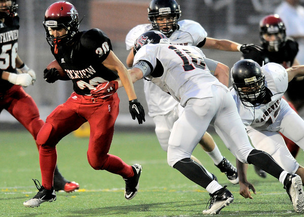 Fairview's Ben Meyer (left) breaks a tackle from Rangeview's Zach Zuhse (right) during their football game at Recht Field in Boulder, Colorado September 8, 2011.   CAMERA/Mark Leffingwell