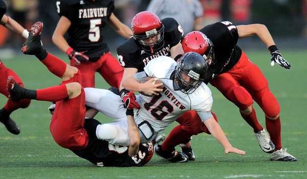 Fairview's Nick Nasky (bottom), Oliver Jenkins (middle) and Andrew Cobb (right) stop Rangeview's Zach Zuhse (front) after a short gain during their football game at Recht Field in Boulder, Colorado September 8, 2011.   CAMERA/Mark Leffingwell