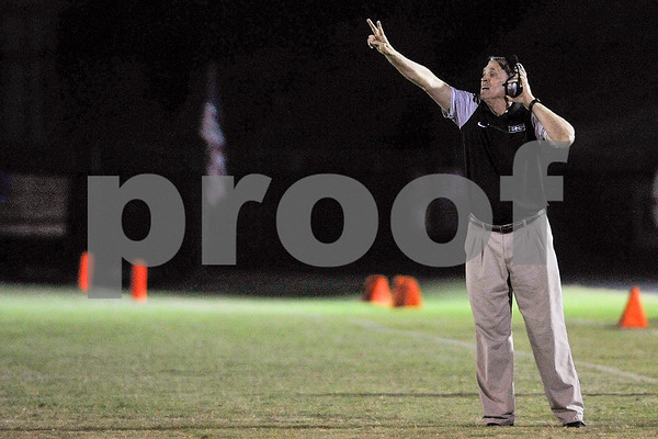 A Bishop T.K. Gorman coach calls a play during a high school football game at Bishop T.K. Gorman Catholic High School in Tyler, Texas, on Friday, Sept. 8, 2017. (Chelsea Purgahn/Tyler Morning Telegraph)