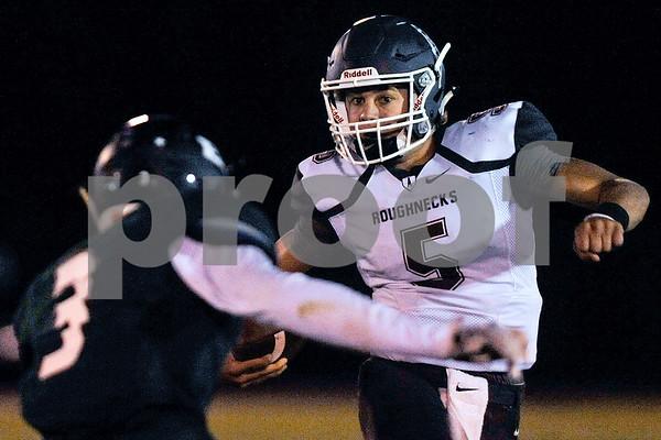 White Oak quarterback Heath Hood (5) runs the ball during a high school football game at Bishop T.K. Gorman Catholic High School in Tyler, Texas, on Friday, Sept. 8, 2017. (Chelsea Purgahn/Tyler Morning Telegraph)