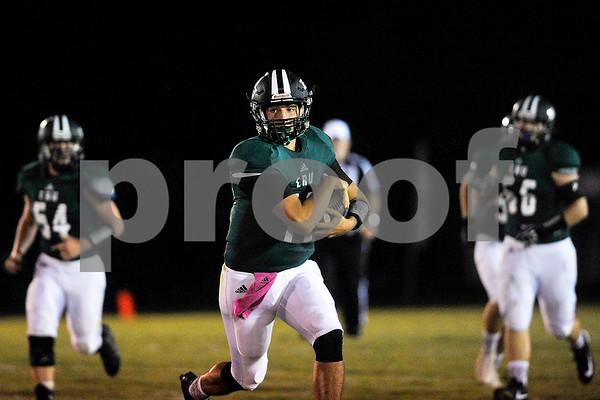 Bishop T.K. Gorman quarterback Jake Smith (12) runs the ball during a high school football game at Bishop T.K. Gorman Catholic High School in Tyler, Texas, on Friday, Sept. 8, 2017. (Chelsea Purgahn/Tyler Morning Telegraph)