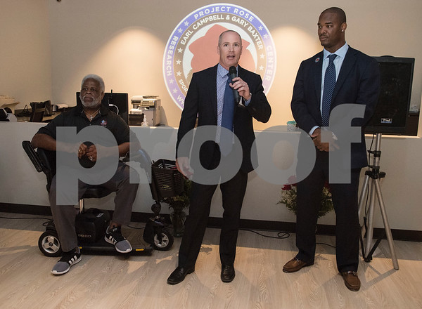Jess Mowery, marketing manager of Texas Spine and Joint Hospital, speaks during a VIP reception held Friday Sept. 8, 2017 in Tyler, Texas. The new center, which is aimed to help former professional athletes, is located inside the Sports Medicine and Therapy Services Department of Texas Spine and Joint Hospital. Pictured at left is former NFL player Earl Campbell and Gary Baxter at right.  (Sarah A. Miller/Tyler Morning Telegraph)