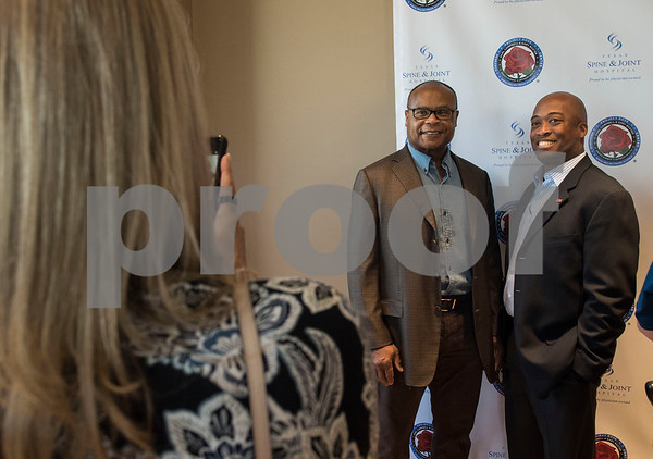 Former NFL player Michael Singletary poses for a photograph with John Redmond, CEO of DynOptix, during a VIP reception held Friday Sept. 8, 2017 in Tyler, Texas. The new center, which is aimed to help former professional athletes, is located inside the Sports Medicine and Therapy Services Department of Texas Spine and Joint Hospital.   (Sarah A. Miller/Tyler Morning Telegraph)