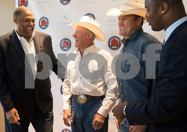 Former NFL player Robert Brazile, left, rodeo athletes Butch Myers and Cash Myers and former NFL player Gary Baxter talk during a VIP reception for the Project Rose Research Institute for Sports Science, located inside the Sports Medicine and Therapy Services Department of Texas Spine and Joint Hospital in Tyler, Texas.    (Sarah A. Miller/Tyler Morning Telegraph)