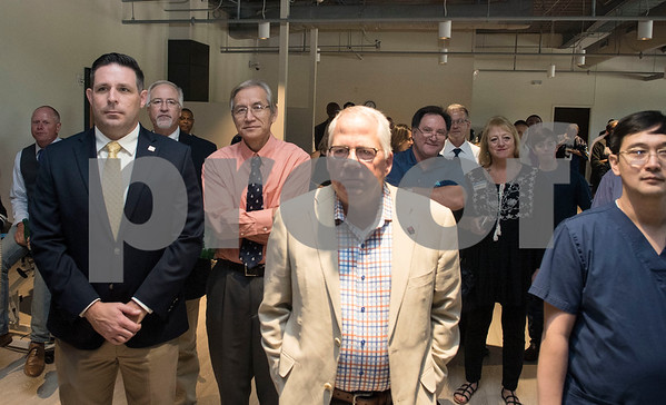 People attend a VIP reception held Friday Sept. 8, 2017 in Tyler, Texas. The new center, which is aimed to help former professional athletes, is located inside the Sports Medicine and Therapy Services Department of Texas Spine and Joint Hospital.  (Sarah A. Miller/Tyler Morning Telegraph)