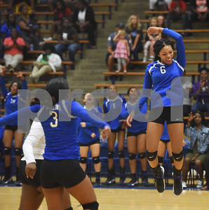 John Tyler's Jazmyne Hicks jumps in the air as she celebrates a point during their volleyball game at home against Robert E. Lee High School Friday night Sept. 9, 2016.  (Sarah A. Miller/Tyler Morning Telegraph)