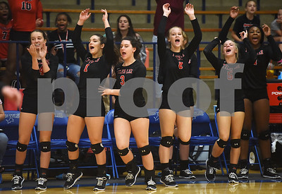 Robert E. Lee volleyball players jump up from the bench to celebrate a point during their volleyball game at the Lions Den Friday night Sept. 9, 2016.  (Sarah A. Miller/Tyler Morning Telegraph)