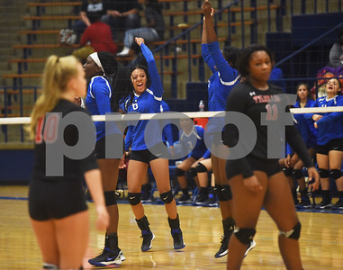 John Tyler's Jazmyne Hicks celebrates a point during their volleyball game at home against Robert E. Lee High School Friday night Sept. 9, 2016.  (Sarah A. Miller/Tyler Morning Telegraph)