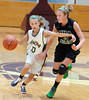 #10 for Fencor, Carolina Mack, attmepts to drive past MBA Select's #3, Nicole Konieczny, during AAU action at Dobyns Bennett. Photo by Ned Jilton II