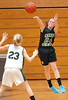 MBA Select's #24, Daly Sullivan, fires a long pass down court over the head of Fencor's #23, Shannon May. Photo by Ned Jilton II