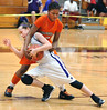 Payton Richards, #4 with the Missouri Valley Magic, struggles against GA Volunteers #12, Tiamya Butler, during AAU action at Dobyns Bennett. Photo by Ned Jilton II
