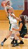 Fencor's #21, Samantha Carangi, battles to hold on to the ball against the defence of MBA Select's #23, Lindsy Morgan Kline during AAU action at Dobyns Bennett. Photo by Ned Jilton II