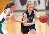 MBA Select's #24, Daly Sullivan, drives past Fencor's #3 Maddison Haney during AAU tournamnet at Dobyns Bennett. Photo by Ned Jilton II