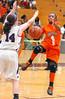 GA Volunteers Taja Cummings, #1, drives for the basket against Missouri Valley Magic's #14, Paige A. Wells. Photo by Ned Jilton II