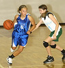 Les Chats #5 Emily Wood dribbles past New Orleans Domino's #1 Madison Raque. Photo by Erica Yoon