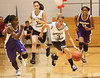Dayton #3 Brittani Rizzi dribbles down the court. Photo by Erica Yoon