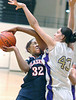 Imani Symone Johnson, #32, for the Missouri Valley Magic/ Blazers Elite runs into #43, Katherine Powell, of the Georgia Pistols while driving toward the basket during the AAU 12-Under National tournament in Kingsport. Photo by Ned Jilton II