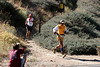 Adaberto Mendoza runs into the Islip Saddle checkpoint during the AC100 race.