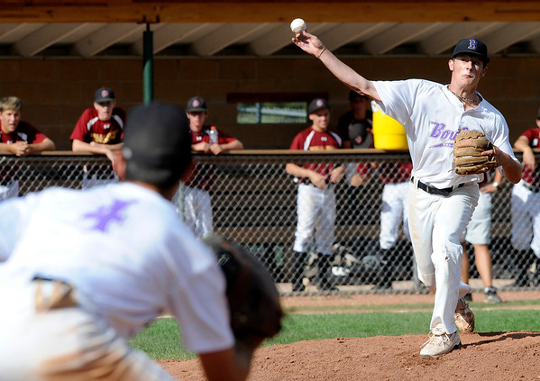 Boulder Eagles' Pitcher #14 Colby Smith throws to first in a pick off attempt in action during their Legion A baseball against the Boulder Wells Fargo Advisors at Scott Carpenter Park on Monday. First baseman David Bote #5 waits for the throw.<br /> Photo by Paul Aiken / The Camera / July 25, 2011