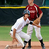 Drew Noolas #4, of the Boulder Eagles slides safely into second in front of Boulder Wells Fargo Advisors #12 Levi Chandler during their Legion A baseball at Scott Carpenter Park on Monday. Noolas scored the first of 4 runs in the first inning for the Eagles. <br /> Photo by Paul Aiken / The Camera / July 25, 2011