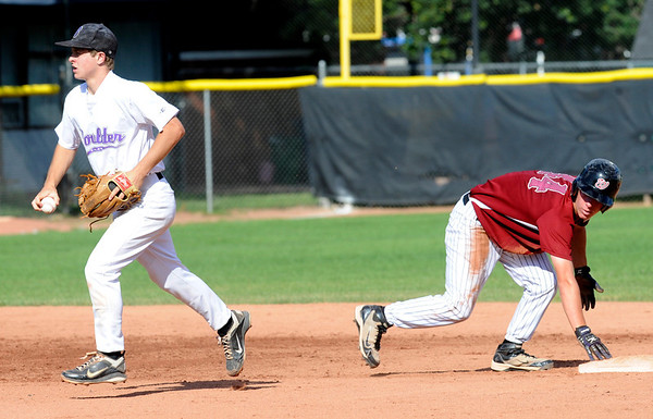 Boulder Wells Fargo Advisors #44 Luke Bukowski can only look back at Boulder Eagles #3 Stephen Galambos runs off after Bukowski was picked off 2nd base to end the first inning during their Legion A baseball at Scott Carpenter Park on Monday. <br /> Photo by Paul Aiken / The Camera / July 25, 2011