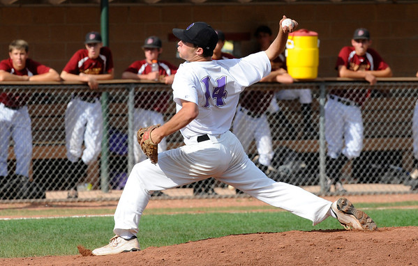 Boulder Eagles' Pitcher #14 Colby Smith in action during their Legion A baseball against the Boulder Wells Fargo Advisors at Scott Carpenter Park on Monday.<br /> Photo by Paul Aiken / The Camera / July 25, 2011<br /> Boulder Wells Fargo Advisors<br /> Boulder Eagles