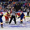 AHL All-Star Challenge  Referee Geno Binda (22) drops the puck for the opening face-off at the War Memorial Arena in Syracuse, New York on Monday, February 1, 2016.