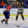 AHL All-Star Challenge Linesman Pete Feola (33) watching Atlantic Division Chris Bourque (17) with the puck at the War Memorial Arena in Syracuse, New York on Monday, February 1, 2016.