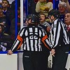 AHL All-Star Challenge Referee Geno Binda (22) and Linesman Jeff Walker (28) checking a play with the off-ice officials at the War Memorial Arena in Syracuse, New York on Monday, February 1, 2016.