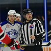 Linesman Jeff Walker (28) talks with Syracuse Crunch Tanner Richard (71) before starting the second period against the Albany Devils in American Hockey League (AHL) action at the War Memorial Arena in Syracuse, New York on Friday, April 8, 2016. Albany won 4-3 in a shootout.  © Scott Thomas Photography