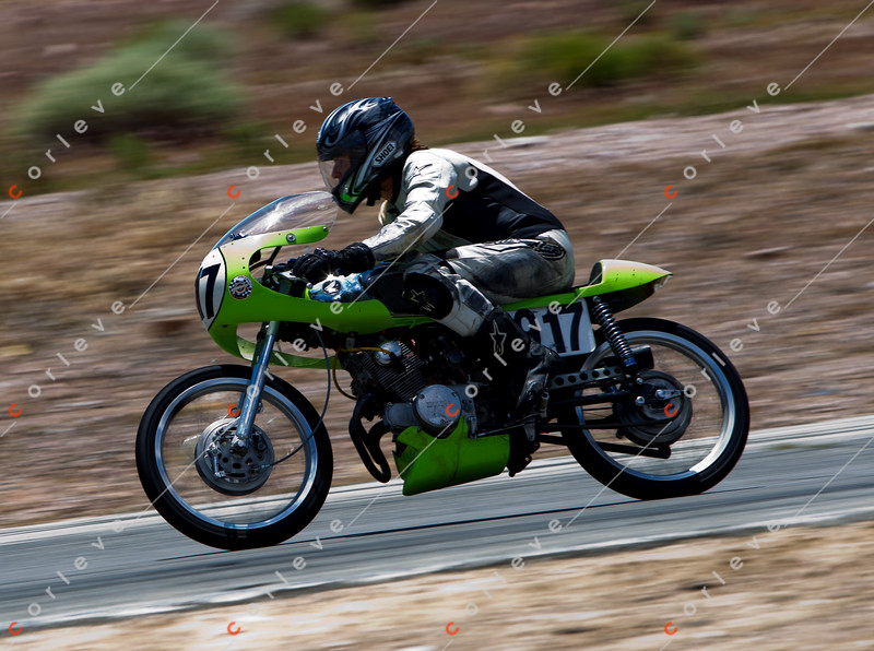 AHRMA Racing 2011 - photographer: Natasha Peterson/Corleve - Ann racing a Kawasaki. Ann is an IT manager by day and racer on the weekends