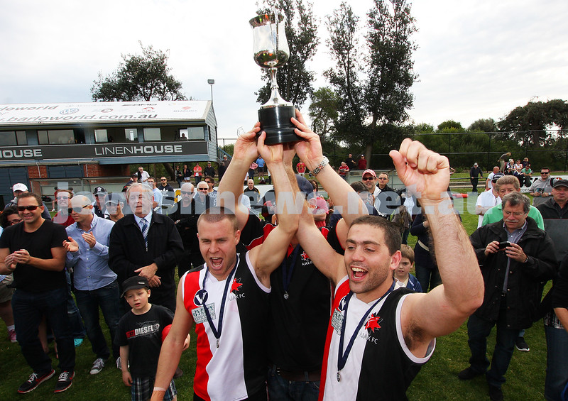 17-9-11. AJAX 2nds  co-captains Josh Givoni (left) and Josh Gotlieb celebrate with the premiership cup after defeating Ormond at Trevor Barker Oval, Sandringham. Photo: Peter Haskin