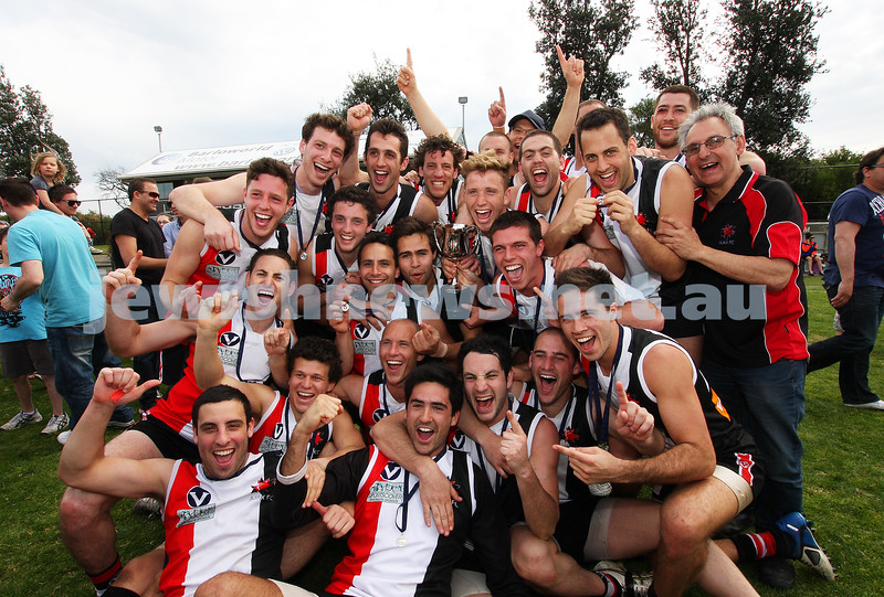 17-9-11. AJAX 2nds celebrate with the premiership cup after defeating Ormond at Trevor Barker Oval, Sandringham. Photo: Peter Haskin