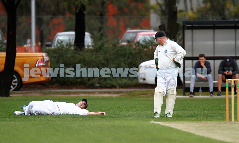 10-11-13. Cricket. AJAX first XI v Monash at Monash University. David Fayman stretching at first slip with keeper Leon jacobs looking on. Photo: Peter Haskin