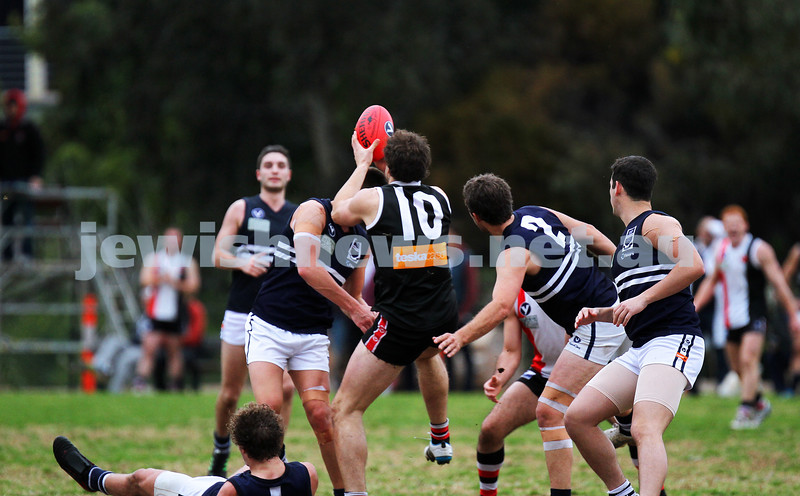 24-8-13. AJAX defeated Caulfield Grammarians by 73 points in the final match of the season. Jason Seidl marking. Photo: Peter Haskin