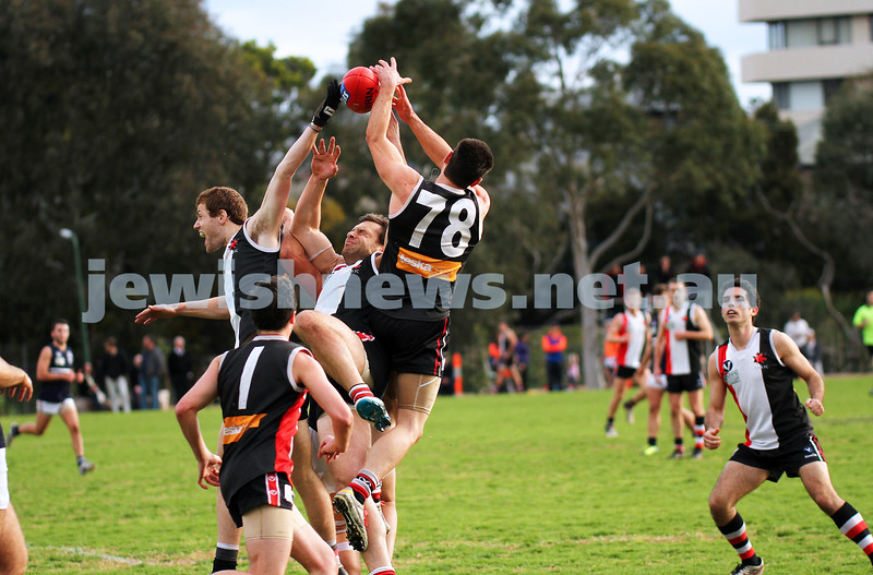 24-8-13. AJAX defeated Caulfield Grammarians by 73 points in the final match of the season.  Jake Lew, Jason Seidle and Eugene Routman fly for a mark. Photo: Peter Haskin