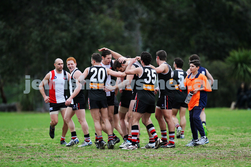24-8-13. AJAX defeated Caulfield Grammarians by 73 points in the final match of the season. Players congratulate Jason Seidl. Photo: Peter Haskin
