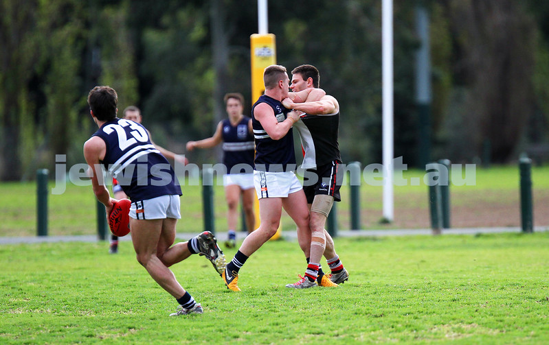 24-8-13. AJAX defeated Caulfield Grammarians by 73 points in the final match of the season.  Eugene Routman having a minor disagreement with his Caulfield opponent. Photo: Peter Haskin