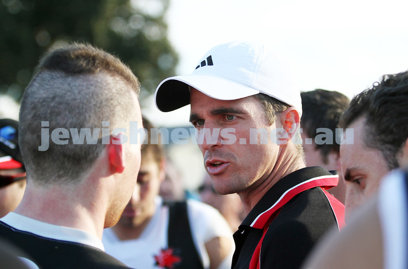 11-5-13. AJAX defeated Old Haileybury at Princes Park, Caulfield. Coach Leigh McQuillen dishing out advice at 3qtr time.  Photo: Peter Haskin