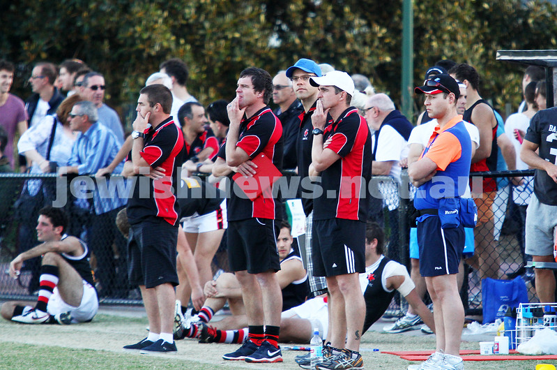 11-5-13. AJAX defeated Old Haileybury at Princes Park, Caulfield.  Coaching staff on the boundary . Photo: Peter Haskin