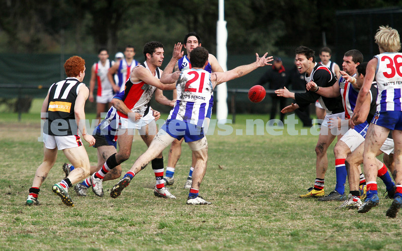 AJAX v Oakleigh. 26-5-12.  Corey Janke firing off a handball. Photo: Peter Haskin