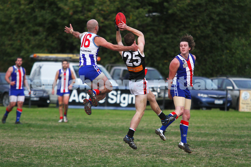 AJAX v Oakleigh. 26-5-12.  Jake Lew marking in front of goal. Photo: Peter Haskin