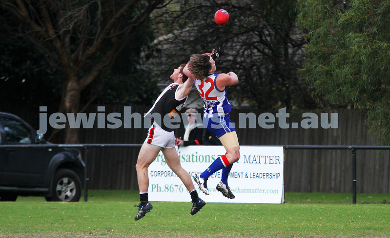 AJAX v Oakleigh. 26-5-12. Jake Lew flies for a mark. Photo: Peter Haskin